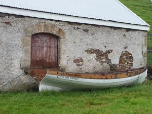 Skiff outside boathouse at Teelin Pier